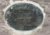 Photo Geodetic Benchmark in base of station north facade
